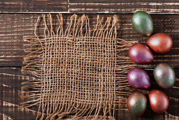 Easter eggs on an old wooden background.