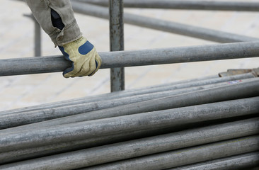 A worker holds a steel pipe as he works on the construction of a stage in central Kiev