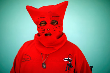 A man dressed as a demon poses for a picture as he participates in a ceremony known as Los Talciguines, as part of religious activities to mark the start of the Holy Week in Texistepeque