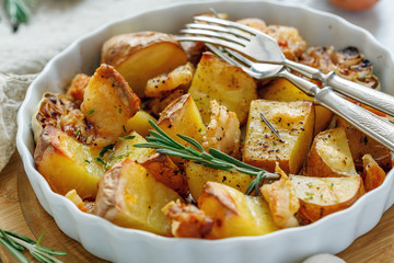 Potatoes baked with bacon, rosemary and garlic.