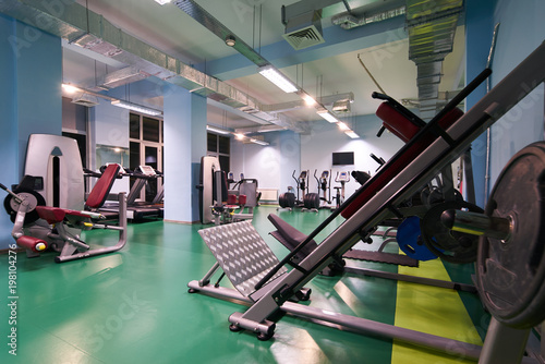 Blurred of fitness gym for fitness workout with sport equipment