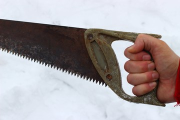 The old saw in hand