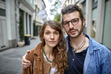 Portrait of young couple in the city