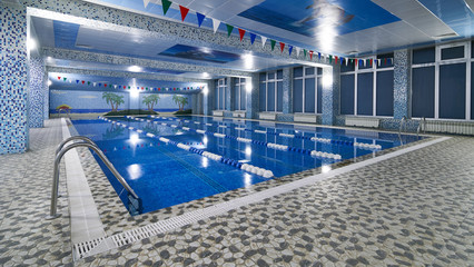 Public competition swimming pool interior in fitness gym club