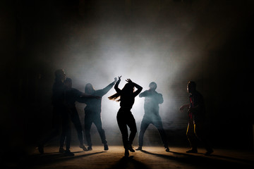 teenagers making dancing moves isoleted on the black background. like moves. fancy of dancing
