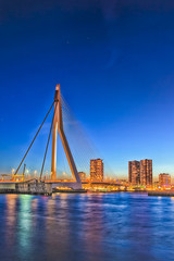 Photo sur Aluminium Rotterdam Travel Concepts. View of Unique and Beautiful Erasmus Bridge in Rotterdam. City Scyline on the Background. Shot Made During Blue Hour.