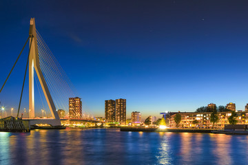 Photo sur Aluminium Rotterdam Unique and Beautiful Erasmus Bridge in Rotterdam with Evening Illumination. City Scyline on the Background. Shot Made During Blue Hour.