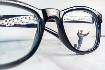Tiny Figurine Cleans Eye Glasses