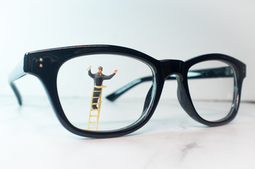 Tiny Figurine Cleans Eye Glasses