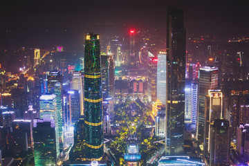 Beautiful wide-angle night aerial view of Guangzhou Zhujiang New Town financial district, Guangdong, China with skyline and scenery beyond the city, seen from the observation deck of Canton Tower
