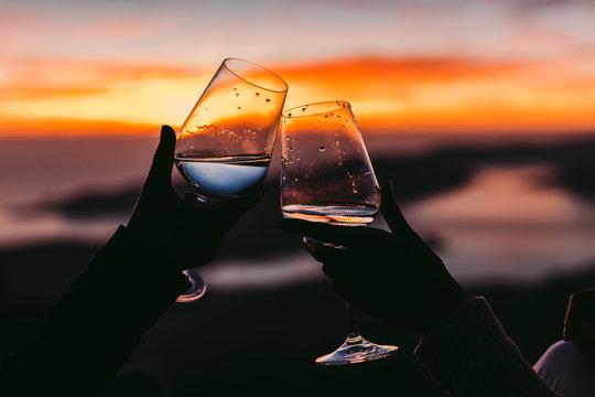 drinking wine at sunset