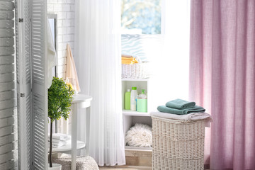 Modern bathroom interior with laundry basket