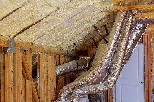 Open AC Heating Vent and Tubing in Ceiling of New Home Construction.