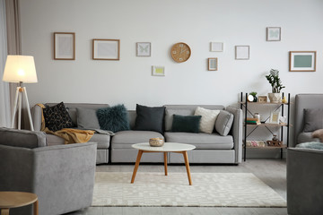 Modern living room interior with comfortable sofa and small table