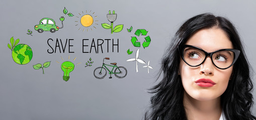 Save Earth with young businesswoman in a thoughtful face