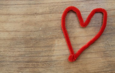 Red craft pipe cleaner shaped as a heart.