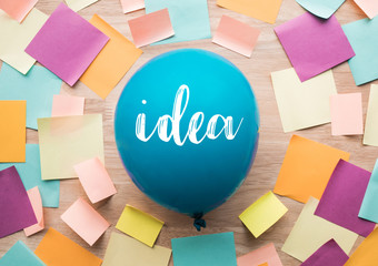 Inspiration ideas concepts with balloon and colorful notepaper on wood table.