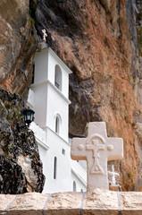 Christian holy cross in rocky Serbian Orthodox monastery Ostrog, Montenegro. St. Vasilije Ostroski (upper church)