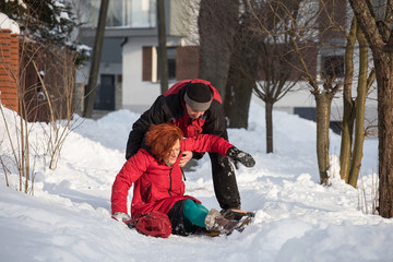 woman slipping on sidewalk  winter accident
