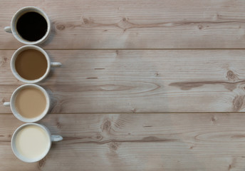 4 cup of coffe on a wooden background with copy space