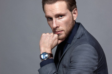 man in with a beard in a wristwatch portrait large