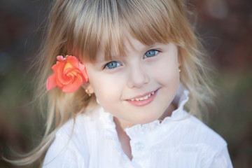 Smiling little girl wiht blue eyes. Beautiful happy child.cute girl.
