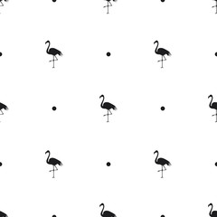 Seamless pattern with silhouettes of a flamingo and dots on white background