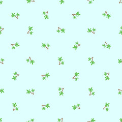 Seamless pattern of small palm trees isolated on green background