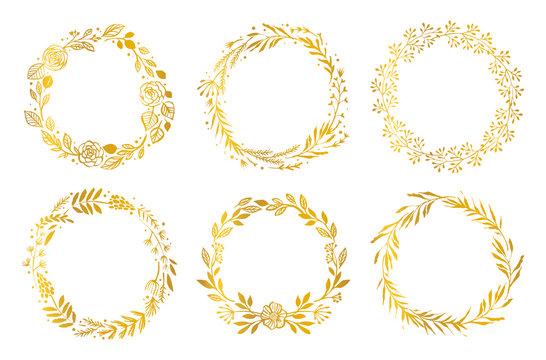 Gold flower wreaths. Hand drawn design elements. Floral pattern vector illustration.