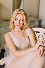 Portrait of beautiful blonde bride in diamod tiara and white underwear