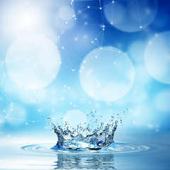 blue water splash on bokeh background.