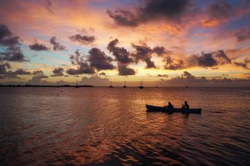 Sailing together under the twilight of Caye Caulker