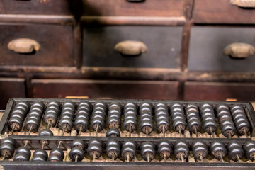 Old classic abacus on the table of an vintage shop from the 19th century.