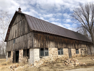 Old wooden barn against a blue sky