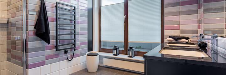 Spacious bathroom with window