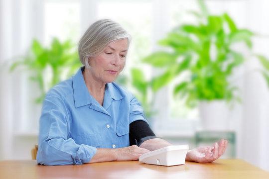 senior woman measuring blood pressure