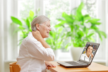 woman neck pain doctor online consultation