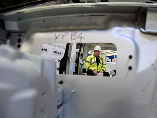 Plant manager Mike Allen sits in a frame for a London Taxi with components made by Hydro Components UK Ltd., in Bedwas
