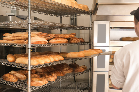 Shelves with delicious fresh bread in bakery