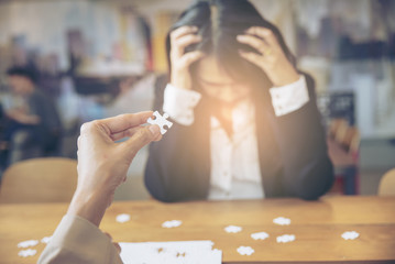 Failure job Concept.Asian Business woman failure on bad job.Unhappy female and headache in work.Business people and jigsaw puzzle.