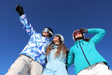 Group of happy friends at ski resort. Winter vacation