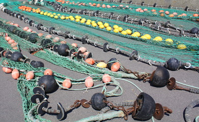 Fishing nets are drying on a background in a harbor
