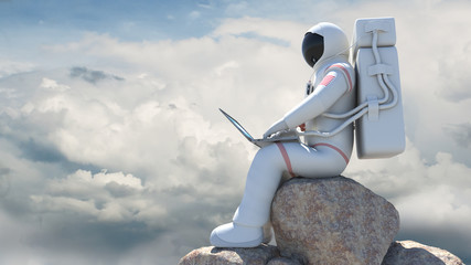An astronaut working with computer with his suit on. Clouds and Blues Sky.