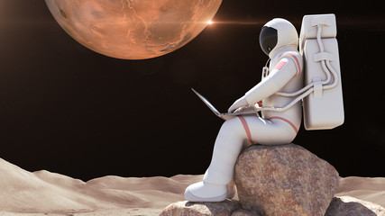 An astronaut working with computer with his suit on. Mars surface, alien planet on background.
