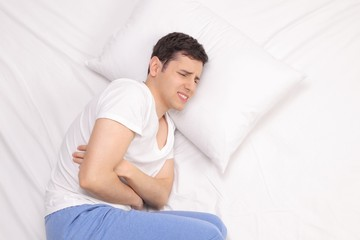 Young man experiencing stomach pain