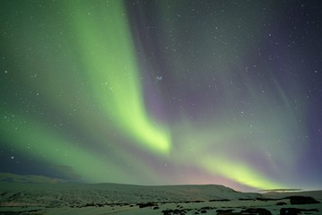 Aurora borealis on a mountain in Iceland 3