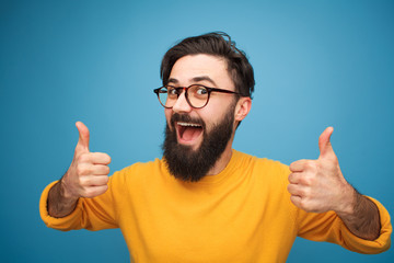 Content bright guy showing thumbs up