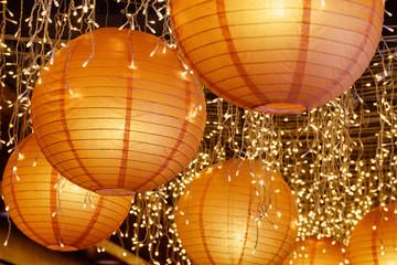 Wonderful paper lanterns among white lights