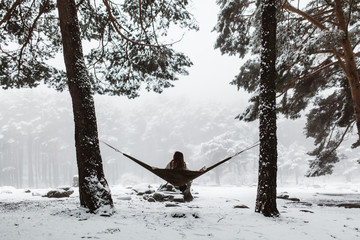 Woman in hammock in winter