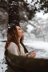 Woman in hammock in winter